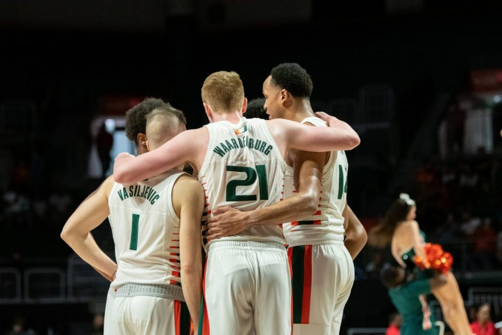 The 'Canes Men's Basketball team huddles during a timeout during Miami's game versus Pittsburgh in the Watsco Center on Feb. 2.