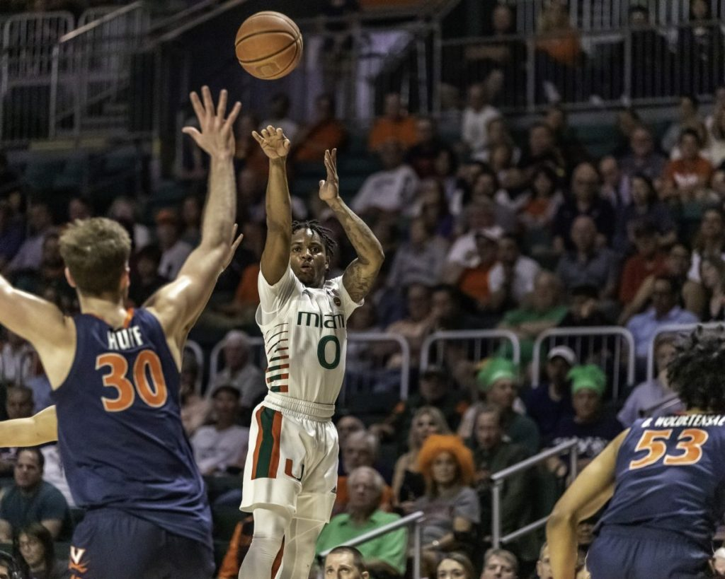 Junior guard Chris Lykes shoots a 3-point shot in Miami's loss to Virginia on March 4, 2020 at the Watsco Center.