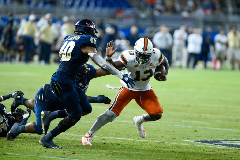 Deejay Dallas (13) stiff arms a defender during the game versus FIU on Saturday, Nov. 23, 2019 at Marlins Park.