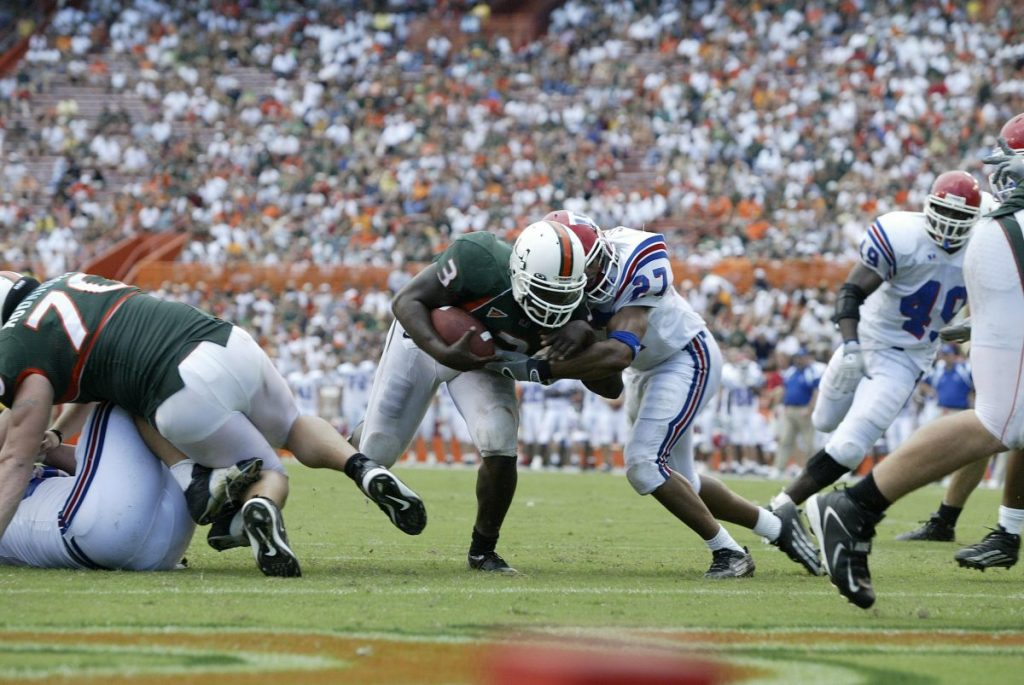 Running Back Frank Gore powers forward during Miami's game versus Louisiana Tech at the Miami Orange Bowl on Sept. 18, 2004.
