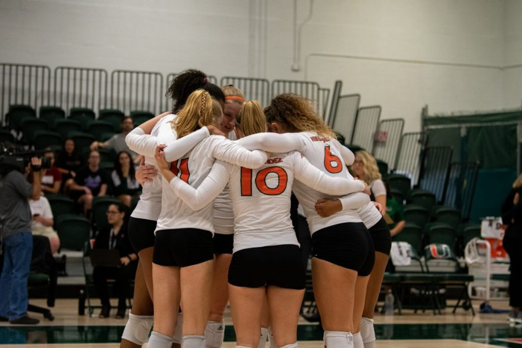 Members of the Canes volleyball team huddle during their match against NC State on Nov. 15, 2019 in the Knight Sports Complex.