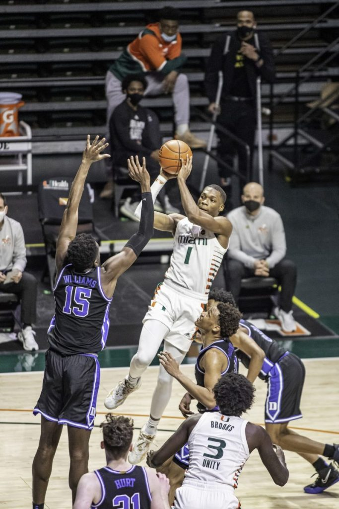 Sophomore Anthony Walker attempts to pass during the late stages of Miami's win over Duke Monday Feb. 1. Walker had 16 points going 6-9 from the field, 1-2 from three, and 3-4 from the line.