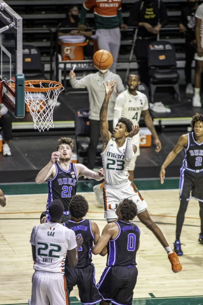 Redshirt Senior Kameron McGusty goes over the top of two Duke players for a bucket in Miami's win over Duke Monday Feb. 1. The Hurricanes shot 52.5% from the field and 53.8% from three point range.