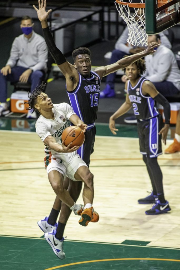 Sophomore Isaiah Wong attempts to draw a foul while he was on his way to 16 points against Duke Monday Feb. 1. The Hurricanes beat The Blue Devils 77-75 as Dukes final shot failed to hit the mark.