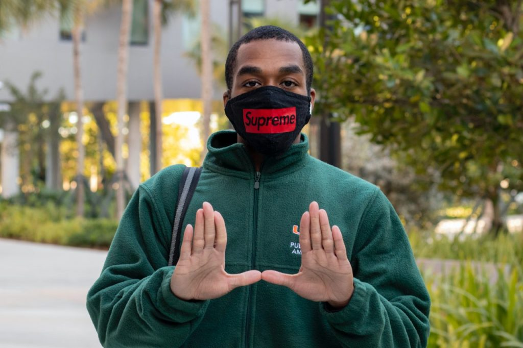 Junior Public Health Ambassador DeAndre Athias poses at Lakeside Village during his shift on Feb. 3. Public Health Ambassadors enforce COVID regulations by encouraging social distancing, wearing face coverings and other safety protocol.