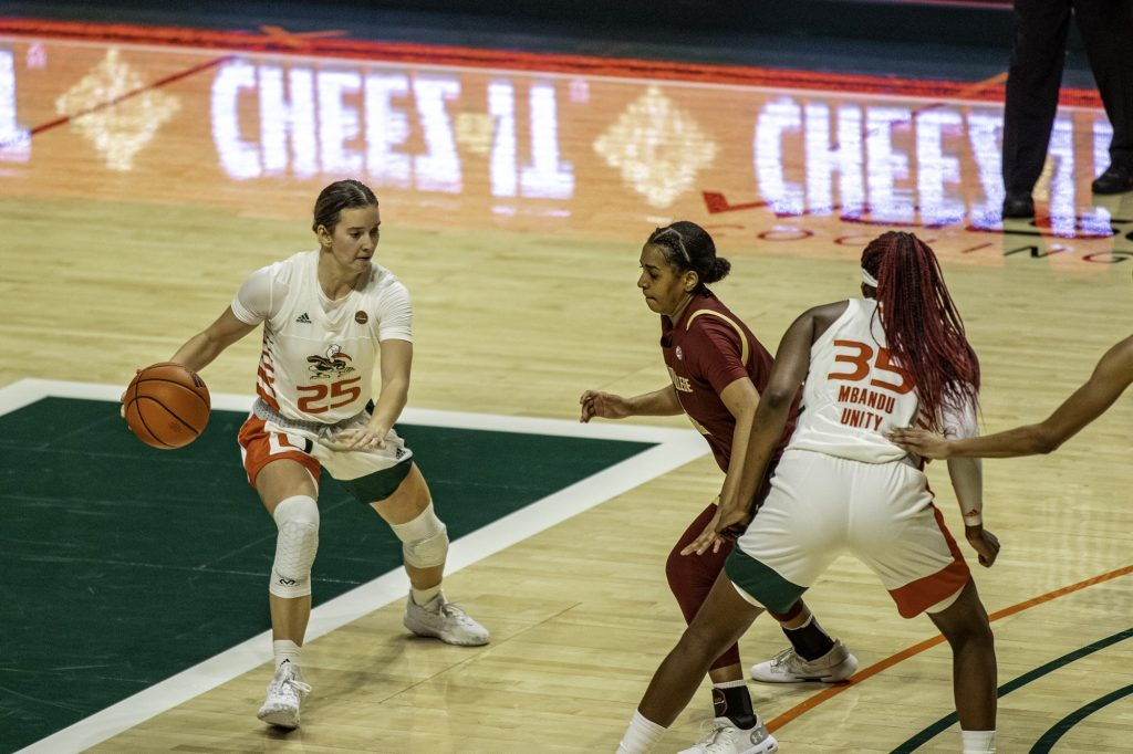 Junior Karla Erjavec moves around the pick during the first half of Miami's win over Boston College Thursday Feb. 18. Erjavec finished the game with 11 points, a rebound, a steal and a pair of assists.