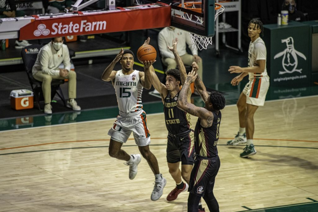 Senior Guard Willie Herenton gets followed on an attempted shot during the second half of Miami's loss to Florida State on Wednesday Feb. 24. Herenton scored 5 points in his 11 minutes on the floor.