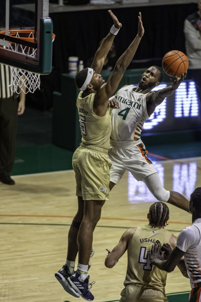 Senior Elijah Olaniyi goes up for a contested layup in the second half of Miami's loss to Georgia Tech on Saturday Feb. 20. Olaniyi led Miami with 18 points.