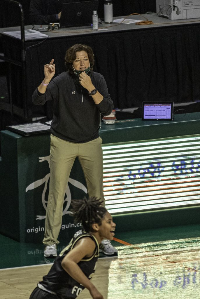 Coach Katie Meyer directs the Canes as they move up the court in the second half of Miami's victory over Wake Forest Thursday Feb. 25. The Canes move to 10-10 on the season.