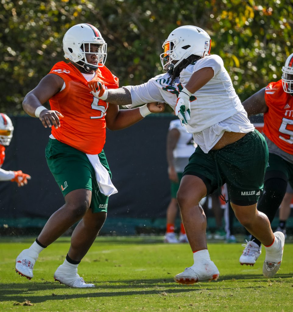 Offensive lineman DJ Scaife, Jr. (left) and defensive lineman Jordan Miller (right) participate in a drill during spring practice.