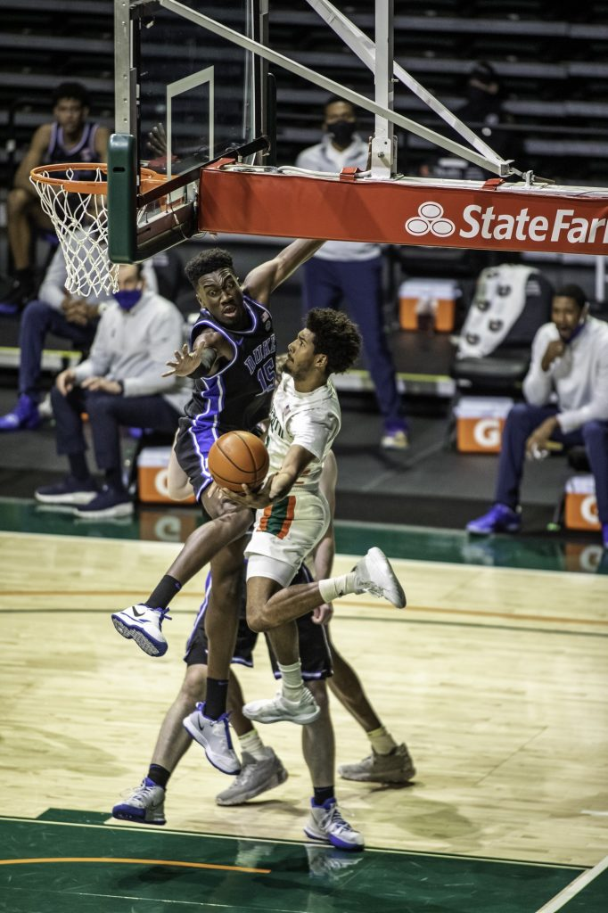 Sophomore Harlond Beverly reaches around the back of the basket in an attempt to make a shot in Miami's win over Duke on Monday, Feb. 1 at the Watsco Center. Beverly sat out the final few games of the regular season as well as the ACC tournament because of injury.