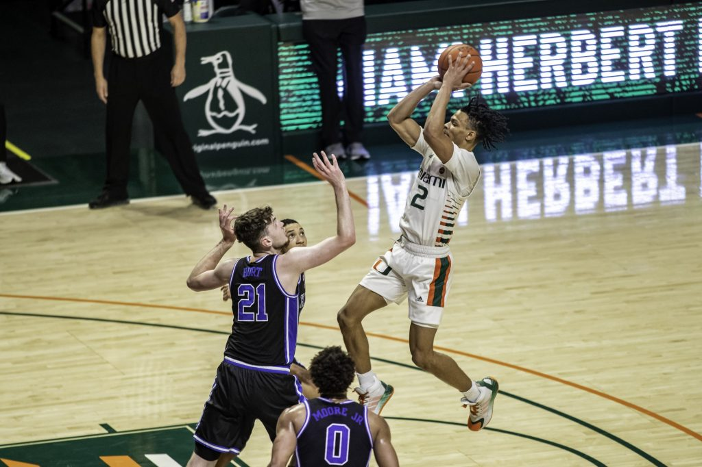 Sophomore Isaiah Wong takes a shot from near the free throw line in Miami's win over Duke on Monday Feb. 1 at the Watsco Center. Wong averaged 17.1 points per game and was named all ACC third team.