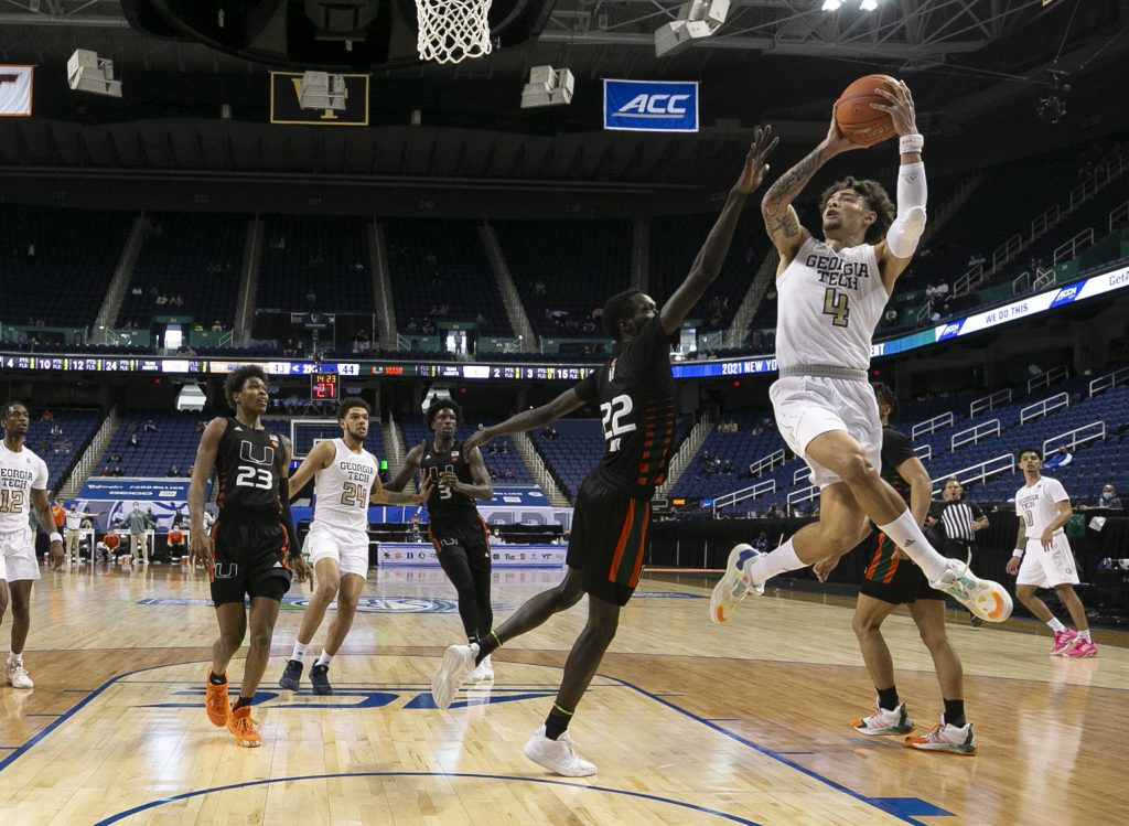 Georgia Tech's Jordan Usher (4) shoots as Miami's Deng Gak (22) defends during Georgia Tech's 70-66 victory over Miami in the quarterfinals of the ACC Men's Basketball Tournament in Greensboro, N.C., Thursday, March 11, 2021.