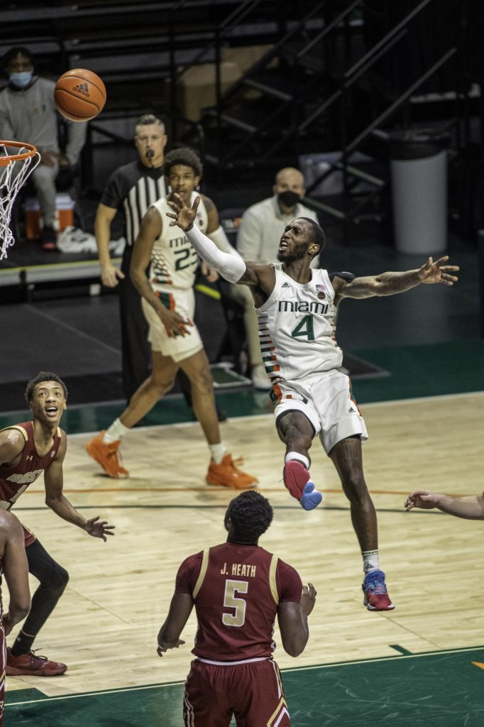 Senior Elijah Olaniyi attempts a shot in Miami's loss to Florida State Wednesday Jan. 27 at the Watsco Center.