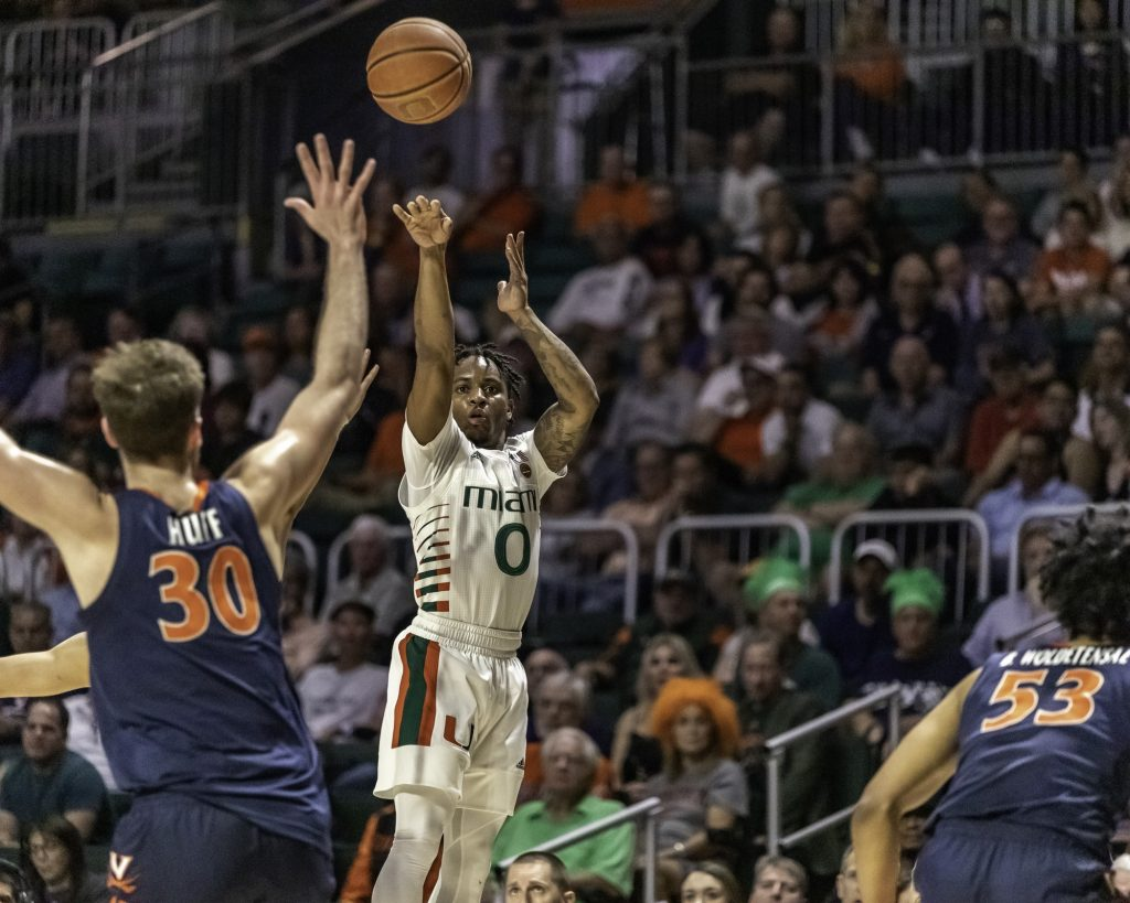 Junior guard Chris Lykes follows through on a 3-pointer near the end of the first half in Miami's loss over Virginia Wednesday, March 4.