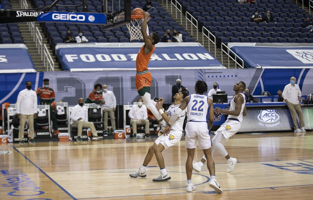 Miami's Anthony Walker (1) gets a dunk during the second half against Pittsburgh on Tuesday, March 9, 2021 during the ACC Tournament at the Greensboro Coliseum in Greensboro, N.C.