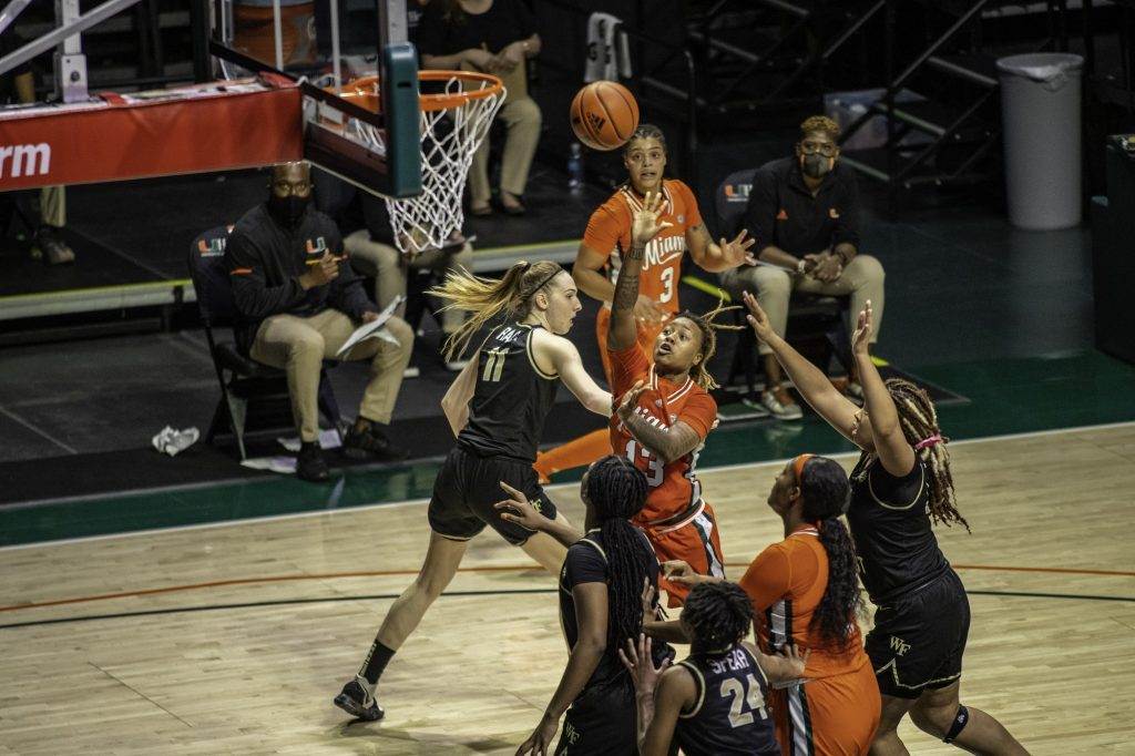 Senior Taylor Mason attempts a shot over a Wake Forest Defender in Miami's win on Thursday Feb. 25 at the Watsco Center. Miami finished the season 11-11 while going 8-10 within the ACC.