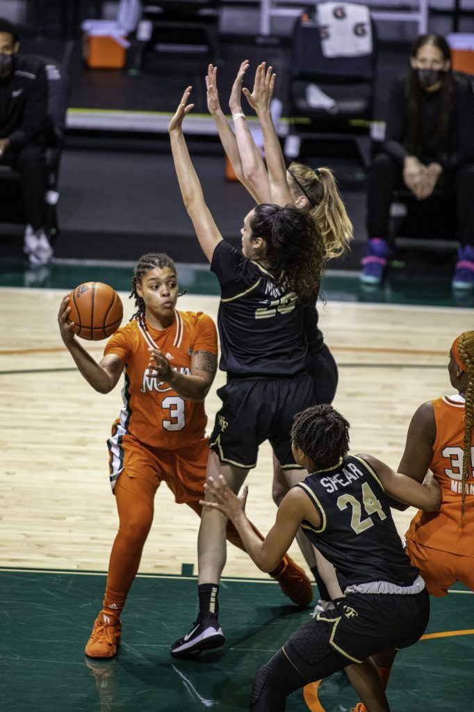 Redshirt Junior Destiny Harden makes a pass around two Wake Forest defenders in Miami's win on Thursday Feb. 25 at the Watsco Center. Marshall Averaged 10 points per game and played in every game this season.