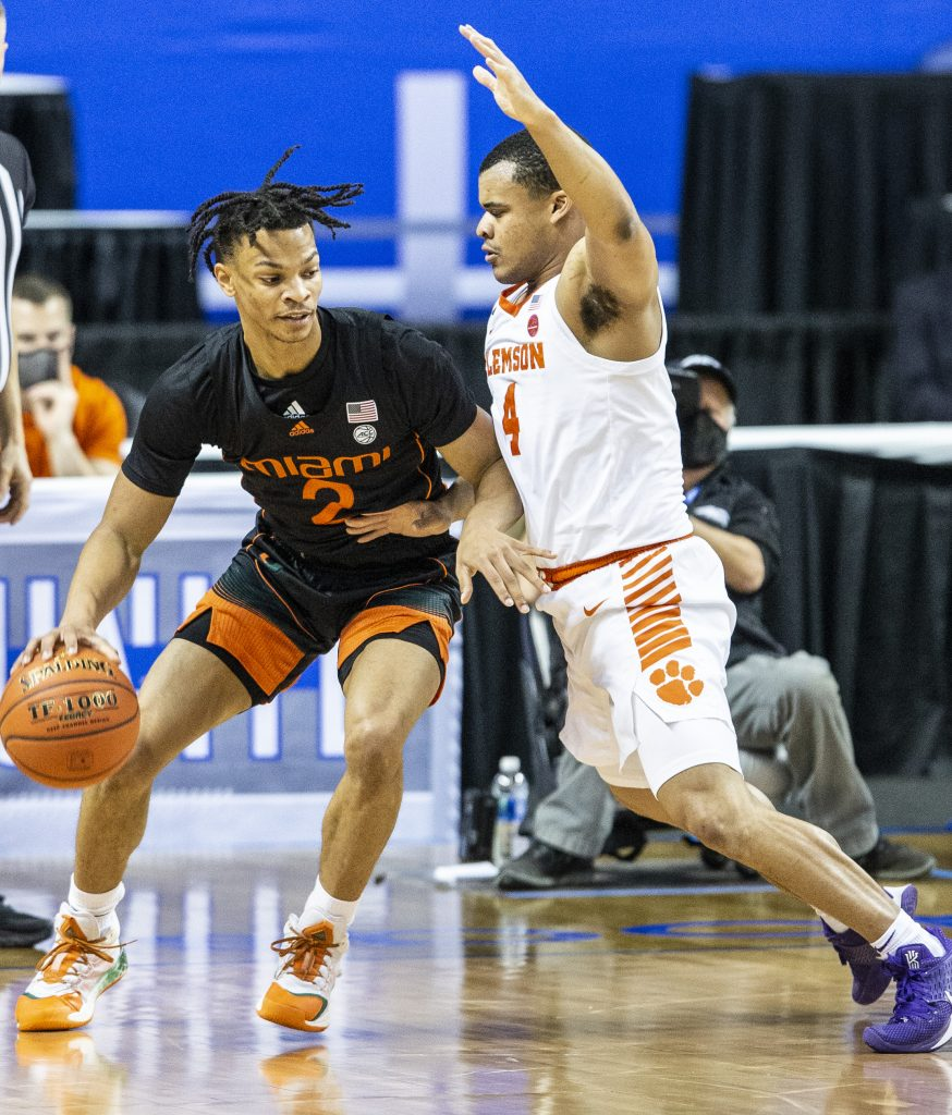 Miami's Isaiah Wong is guarded by Clemson's Nick Honor during an NCAA college basketball game in the second round of the Atlantic Coast Conference tournament in Greensboro, N.C., on Wednesday, March 10, 2021.