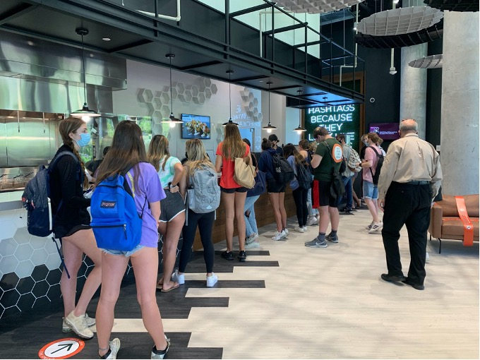 After ordering, students wait at the counter to pick up their waffles. During the lunchtime rush, some students waited a half hour or more between ordering and receiving their food.