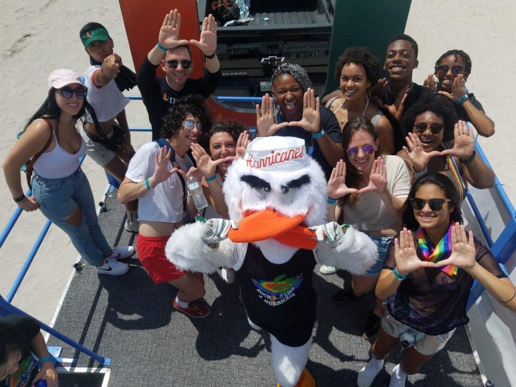 Students show pride at the annual Miami Beach Pride along with University of Miami Mascot Sebastian. Miami Beach, 2019.