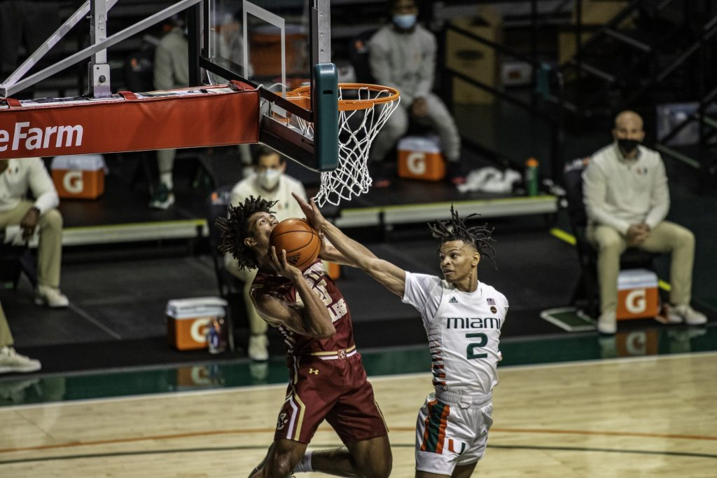 Sophomore Isaiah Wong tries to get a block, but ends up giving up a shooting foul during the first half of Miami's win over Boston College Friday Mar. 5. Wong put up nine points only shooting 3-11 from the field and 2-5 from three point range.