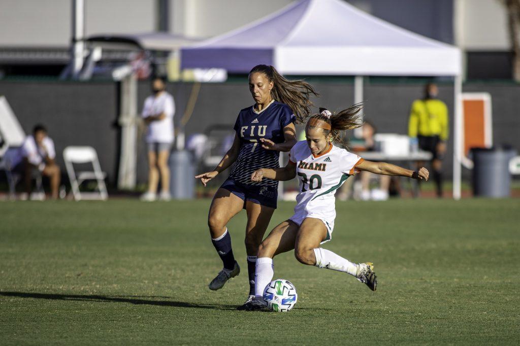 Freshman Michaela Baker fights off a defender in Miami's win over FIU Sunday March, 14. Miami scored four goals in the win.