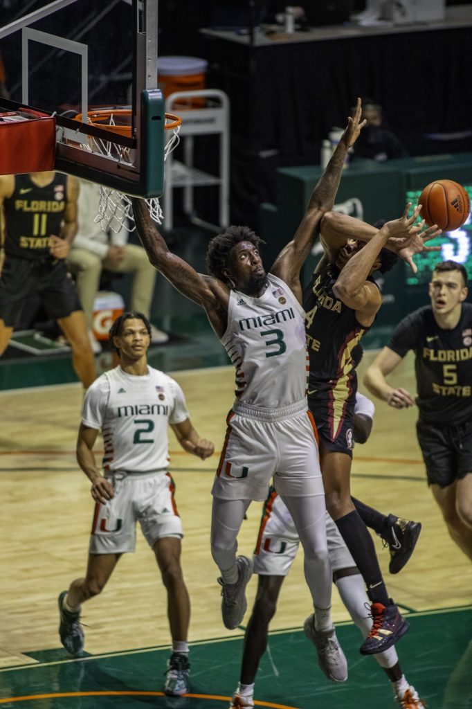 Redshirt senior Nysier Brooks attempts to block a Florida State shot in Miami's loss on Wednesday Jan. 27 at the Watsco Center. Brooks led the team with 26 blocks on the season.