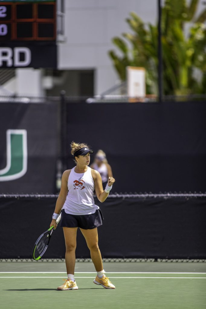 Sophomore Diana Khodan pumps her fist after scoring a point in her match on Sunday March 21 at the Neil Schiff Tennis Center. Khodan won her singles match 6-0, 6-1.