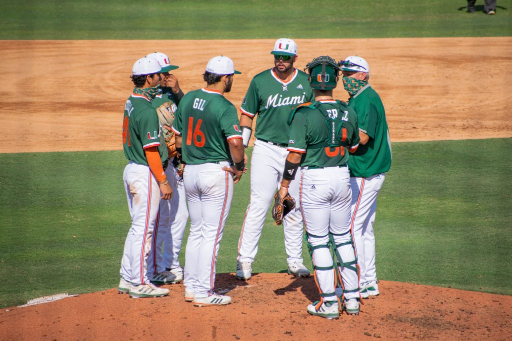 The Miami Hurricanes huddle on the pitchers mound during Miami's game against Florida Gulf Coast University on April 14 at Mark Light Field.