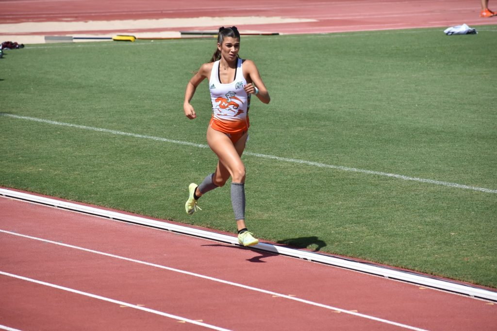 Natalie Varela runs during the Hurricane Collegiate Invitational at Cobb Stadium on March 27.