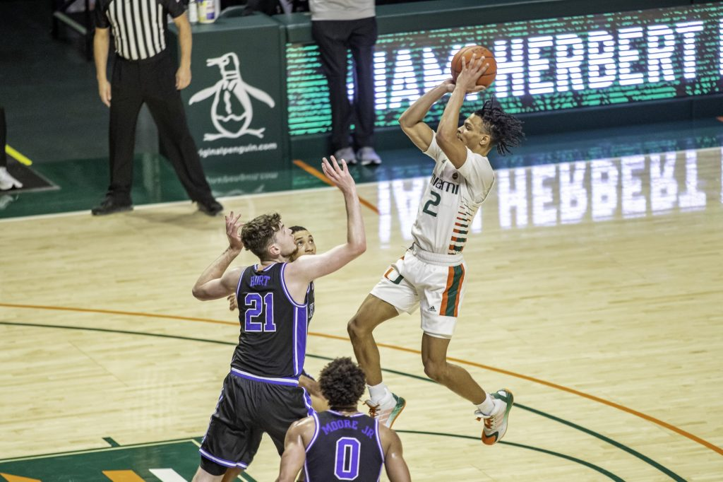 Sophomore guard Isaiah Wong shoots during Miami's game against Duke on February 1 at the Watsco Center.
