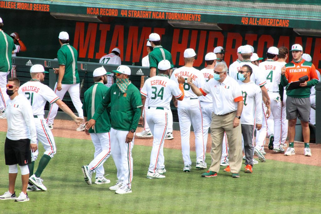 The Hurricanes celebrate after sweeping Duke on Sunday, April 4 at Mark Light Field.