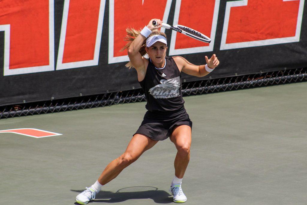 Estela Perez Somarriba returns a shot during Miami's match on April 4 against Virginia at the Neil Schiff Tennis Center.