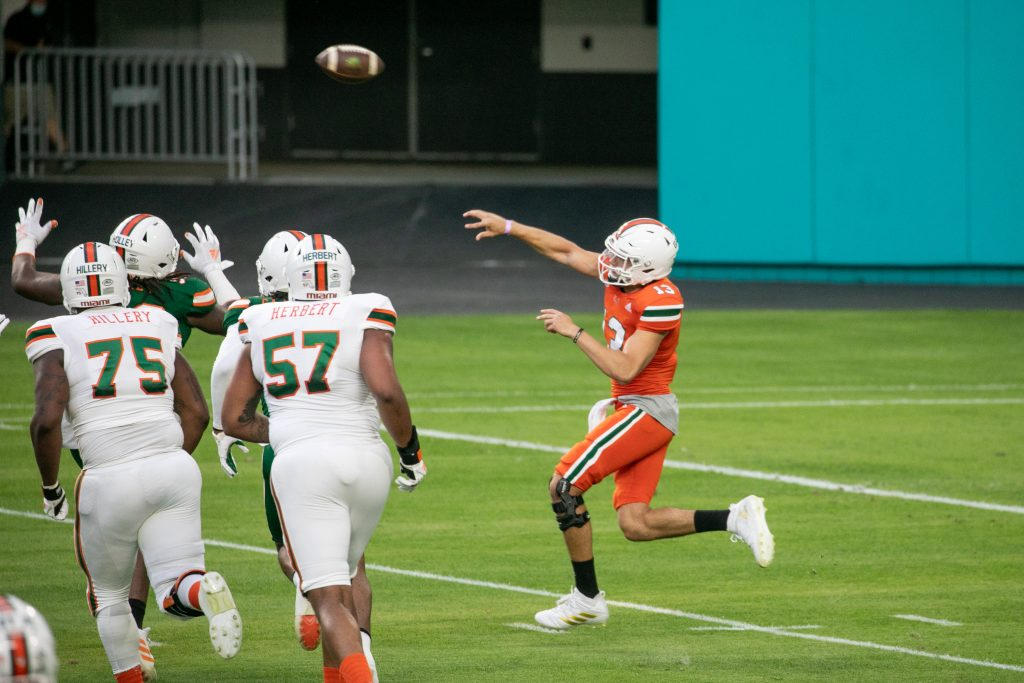 Jake Garcia, a true freshman who enrolled early in January, throws a pass during Miami's second scrimmage of the spring season.