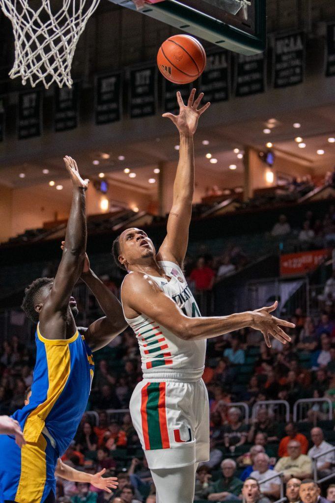 Rodney Miller (14) shoots a layup against Pitt on Dec. 16, 2019 at the Watsco Center.