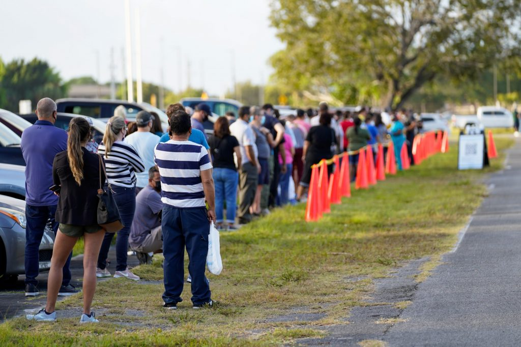 Florida residents line up at a county-supported pop up vaccination site at Homestead Air Reserve park on Wednesday, March 31, 2021. This vaccination site had 400 doses of the Johnson & Johnson Covid-19 vaccine available for individuals 40 years of age or older, or those who qualified under another category within the eligibility requirements.