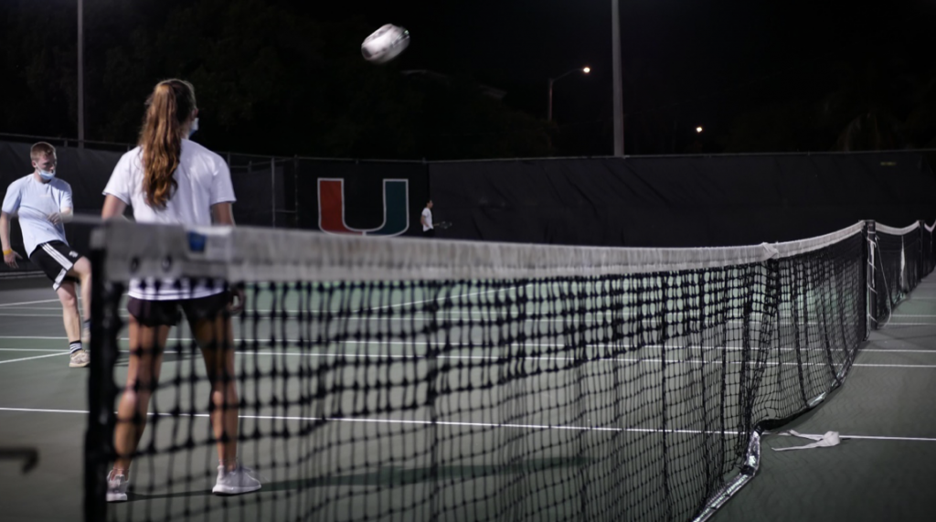 Eben Butler, left, sends the ball back to his opponent at the UM tennis courts on March 31.