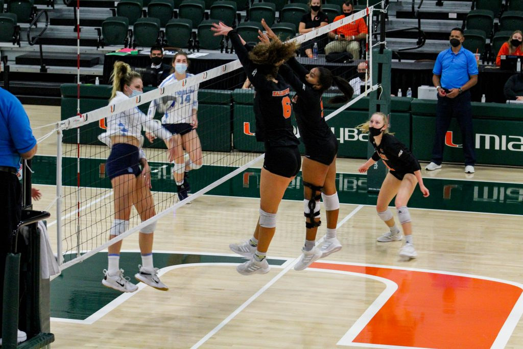Miami attempts to deflect a UNC kill attempt during the match on April 3 at the Knight Sports Complex. Miami won the match 3-1.