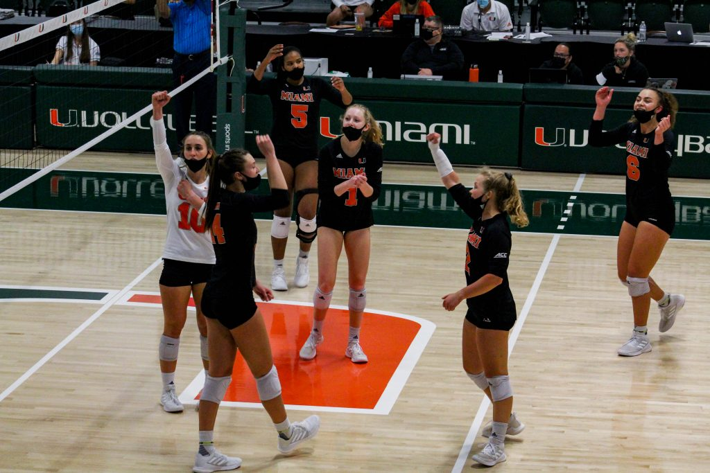The Hurricanes cheer after winning a point during their match against the UNC Tar Heels on April 3. It was the last match of the spring season for Miami.