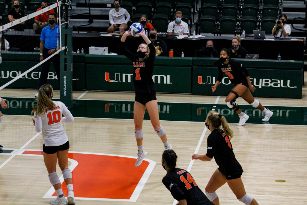 Miami sophomore setter Savannah Vach (1) sets the balls during Miami's match against the University of North Carolina on April 3 at the Knight Sports Complex.