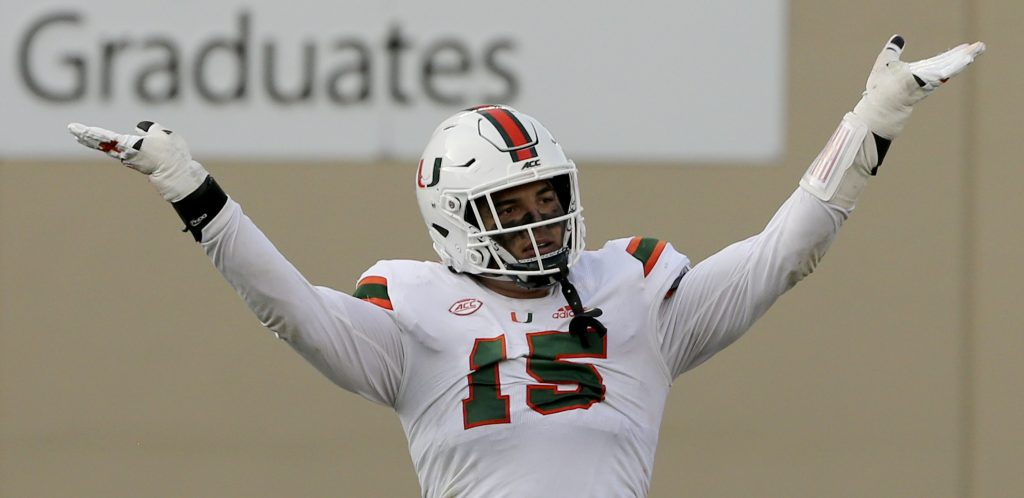 Jaelan Phillips celebrates a defensive stop during the second half of the University of Miami  - Virginia Tech NCAA college football game on Saturday, Nov.14 2020, in Blacksburg, Va.