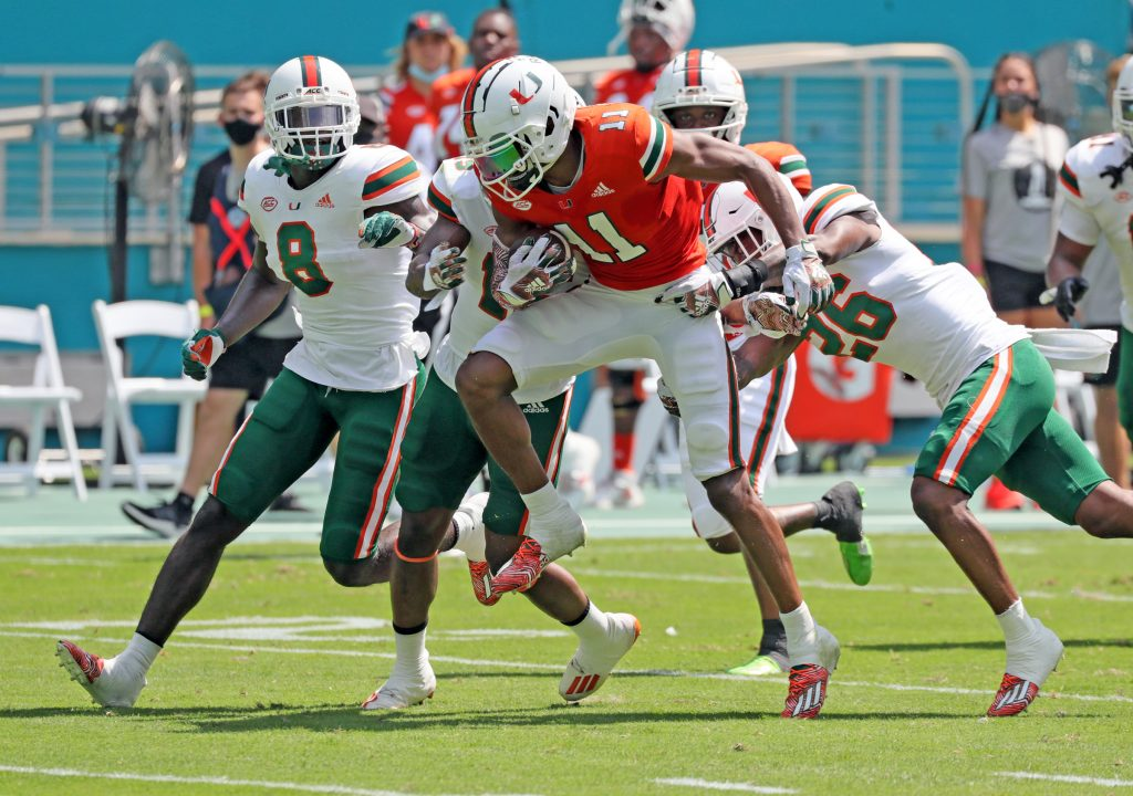 Miami Hurricanes wide receiver Charleston Rambo (11) gains yardage after a pass reception during spring game at Hard Rock Stadium in Miami Gardens on Saturday, April 17, 2021.