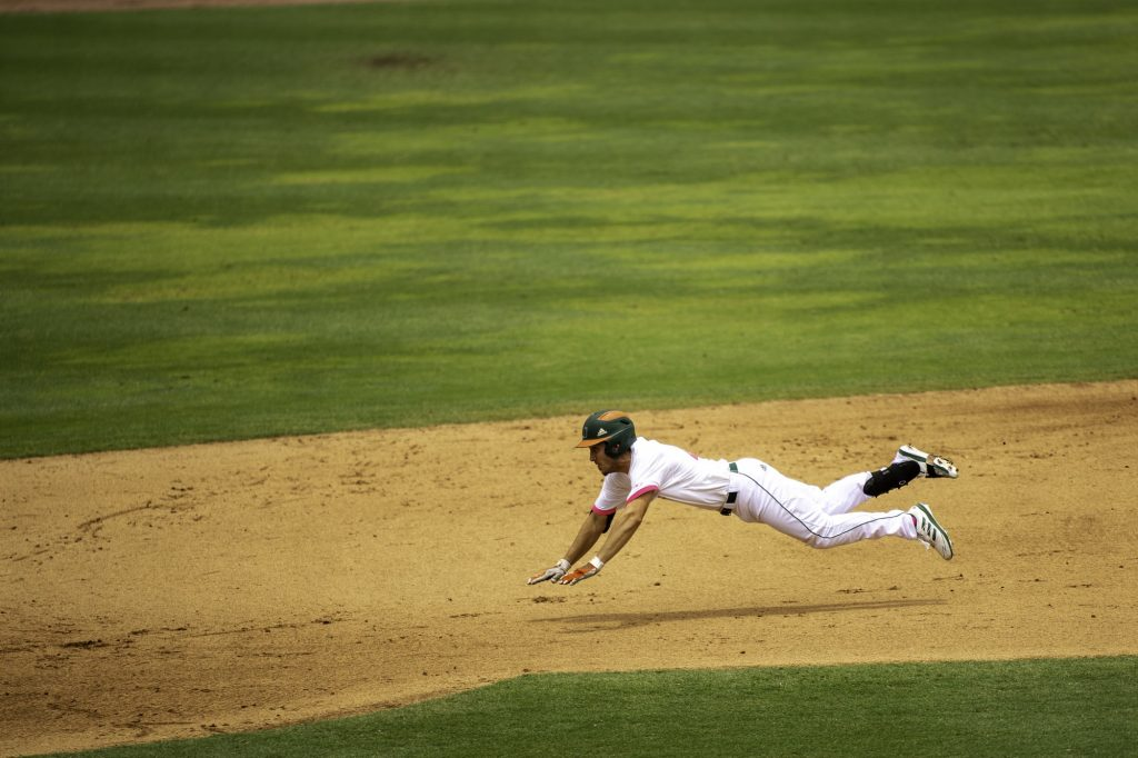 Redshirt junior Christian Del Castillo makes a long diving slide into second base in Miami's win over Appalachian State on Sunday May 9 at Mark Light Field. Del Castillo tallied three hits in three at bats for the Canes' in their 10-2 victory.