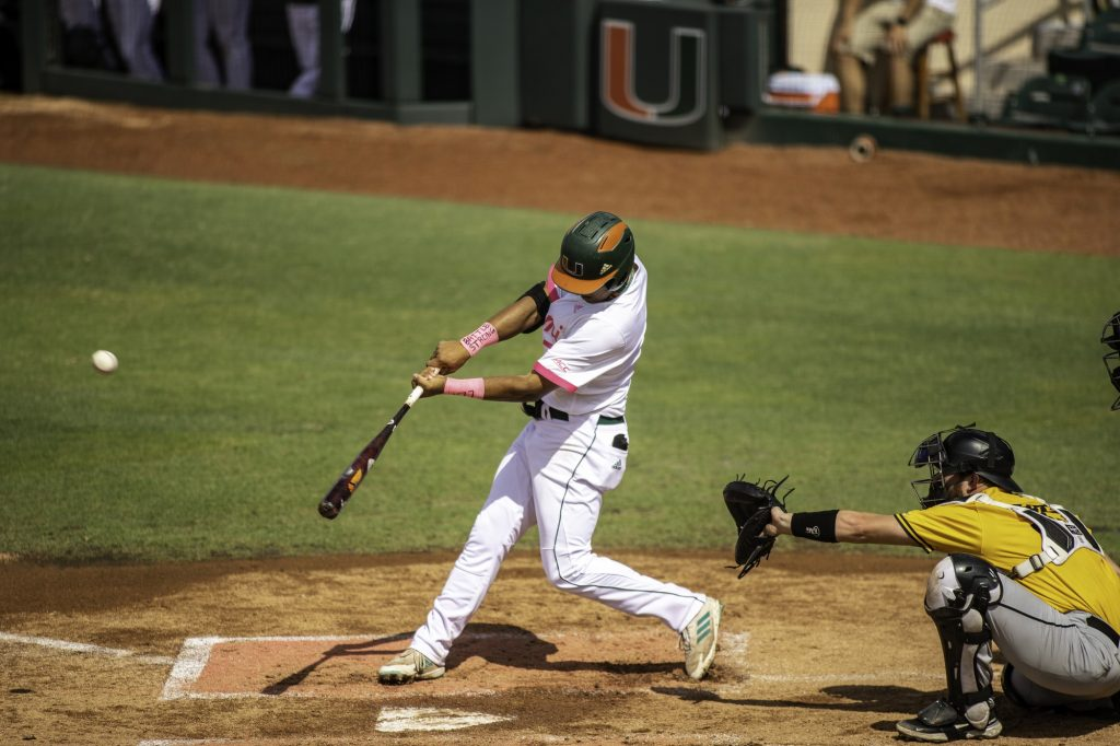 Sophomore Anthony Vilar follows through on a hit in Miami's win over Appalachian State on Sunday May 9 at Mark Light Field. Vilar registered one hit, two walks, and scored three times in the Canes' 10-2 victory on Sunday.