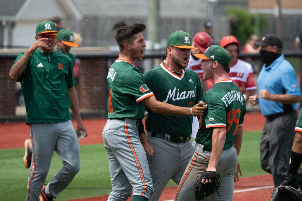 The Hurricanes celebrate a victory over the Louisville Cardinals on May 22 in Louisville, Kentucky.