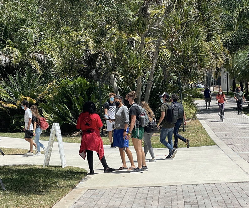 Symptom checkers are stationed at several campus entrances to survey students about their general health and if they have had any exposure to COVID.