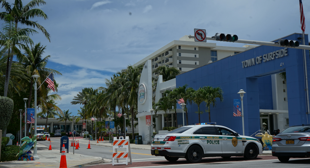The Surfside Tourist Information Center sits directly in front of the ongoing support effort at the Surfside Community Center on Saturday, June 26. County police have blocked off this street, along with many of Surfside's now heavily congested roadways.
