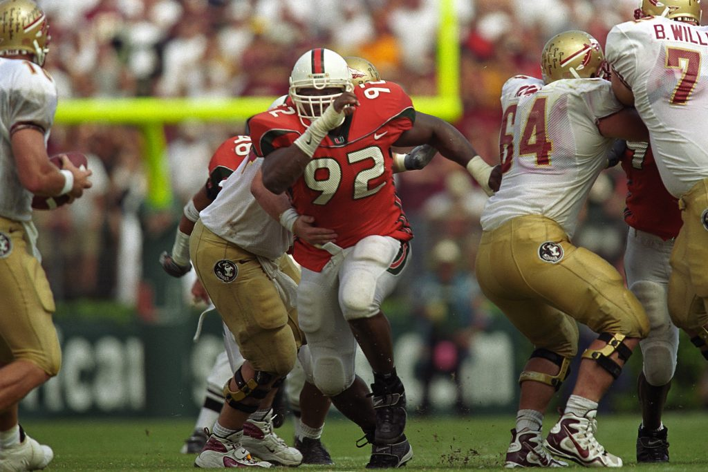 Damione Lewis (92) breaks through the line and runs towards FSU quarterback Chris Weinke in the legendary Wide Right II, where No. 7 Miami won 27-24 over No. 1 Florida State.