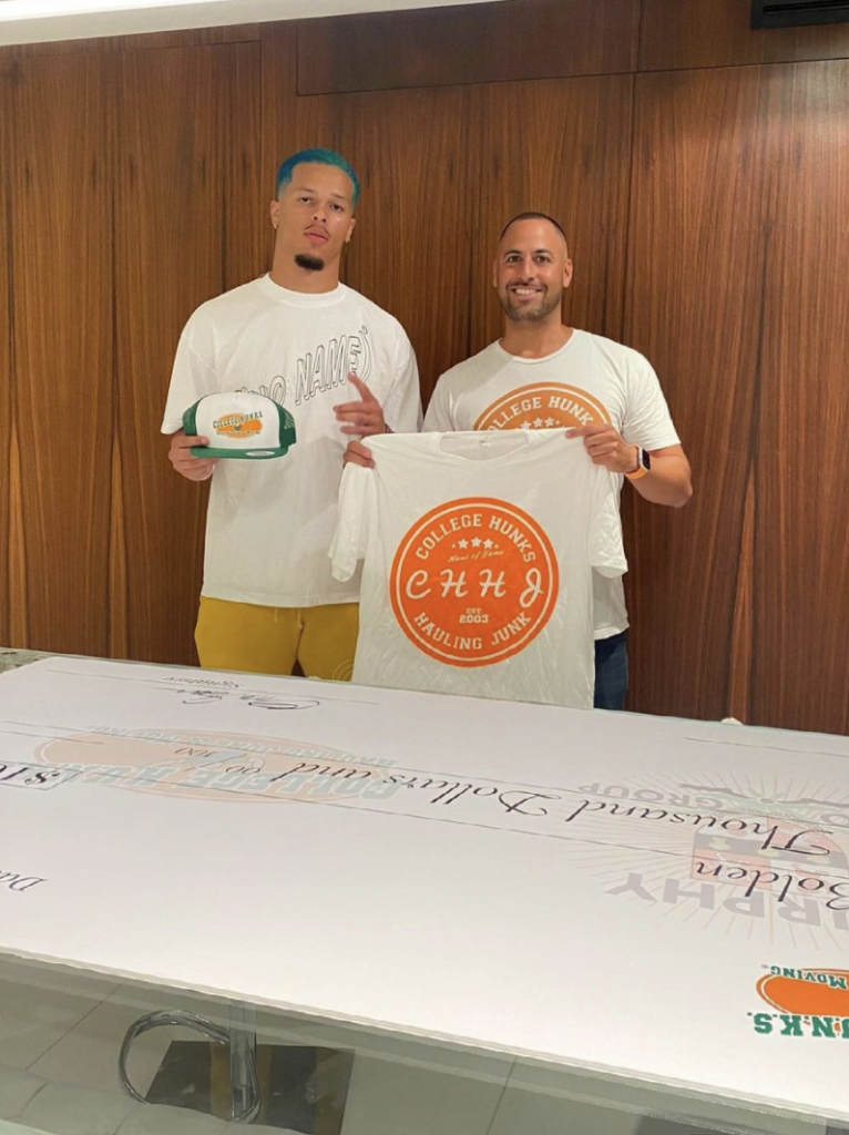 King's teammate and fellow senior Bubba Bolden (left) is pictured after signing an endorsement deal with College Hunks Moving Junk.